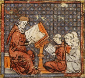 Figure 1. This illustration from the Grandes Chroniques de France, shows a group of students and their instructor wearing robes during a philosophy lesson in the late 14th century. [Image credit: Wikipedia]