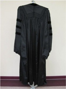 Figure 6. The front and back of George Santayana's doctoral gown. This gown is very similar to the one shown in Figure 5 apart from the crow's feet on the lapels of King's robe. [Image credit: Kristin Lee]